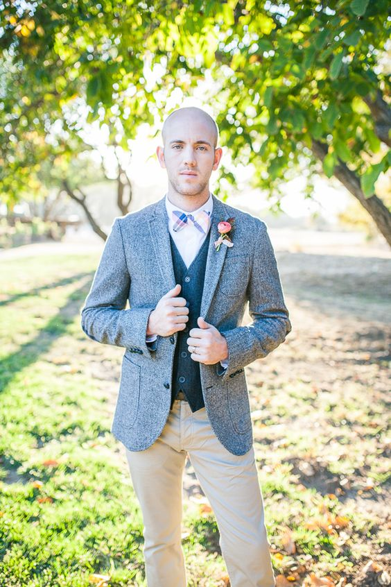 neutral pants, a dark grey vest, a light grey jacket and a colorful bow tie for a whimsy touch