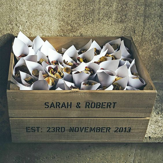 a crate with flower petals for the wedding exit