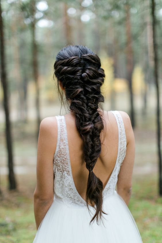 a creative twisted braided hairstyle on long and thick hair for a relaxed look