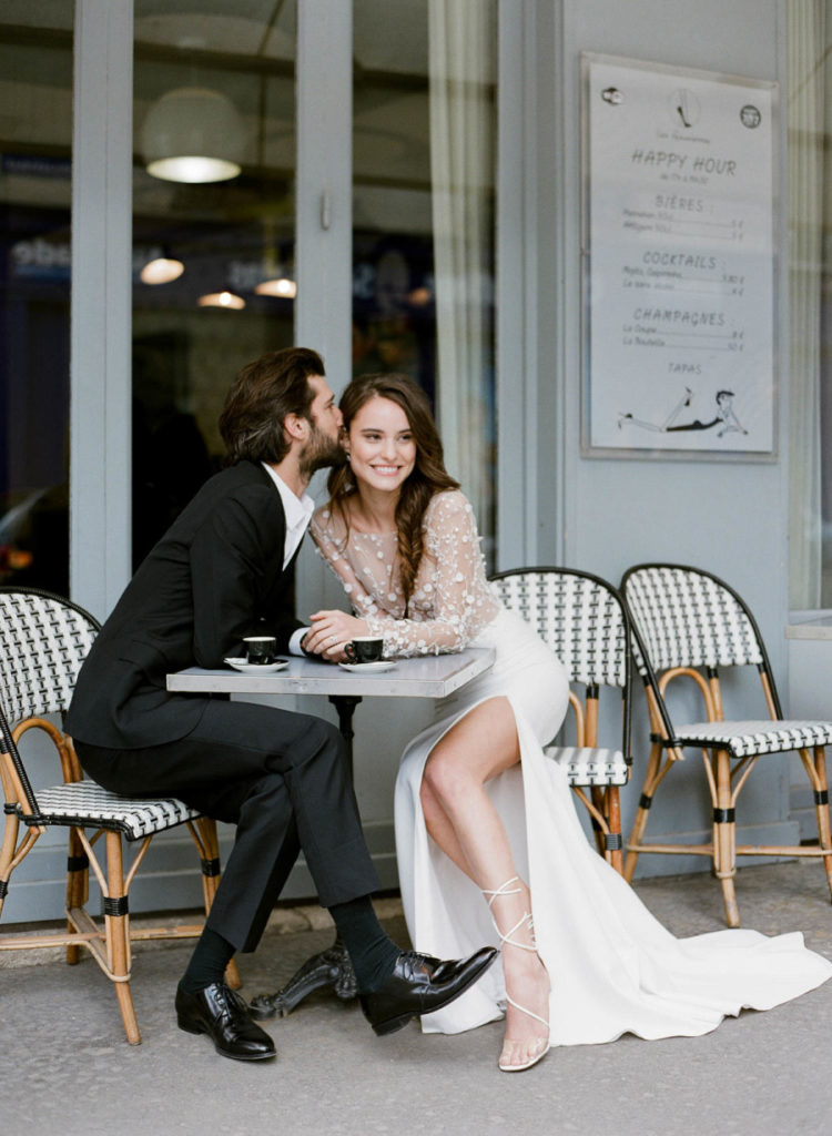 a modern wedding gown with a lace applique long sleeve bodice and a plain skirt with a side slit