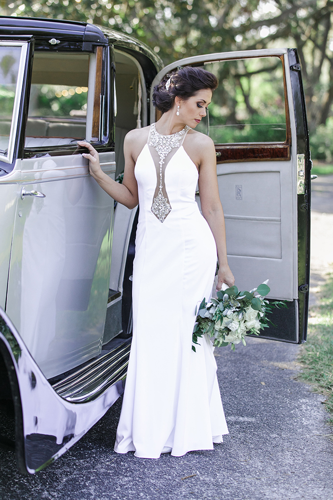 a vintage sheath wedding gown with an embellished illusion neckline for a romantic and sexy feel