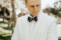 23 accent the look with a floral printed bow tie to make the outfit not so formal