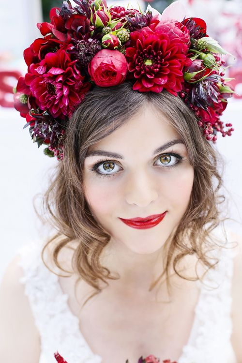 an oversized floral crown in the shades of red and burgundy plus a red lip for a bold fall bridal look