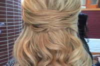 24 a chic half updo with twists and curly hair down for middle length hair