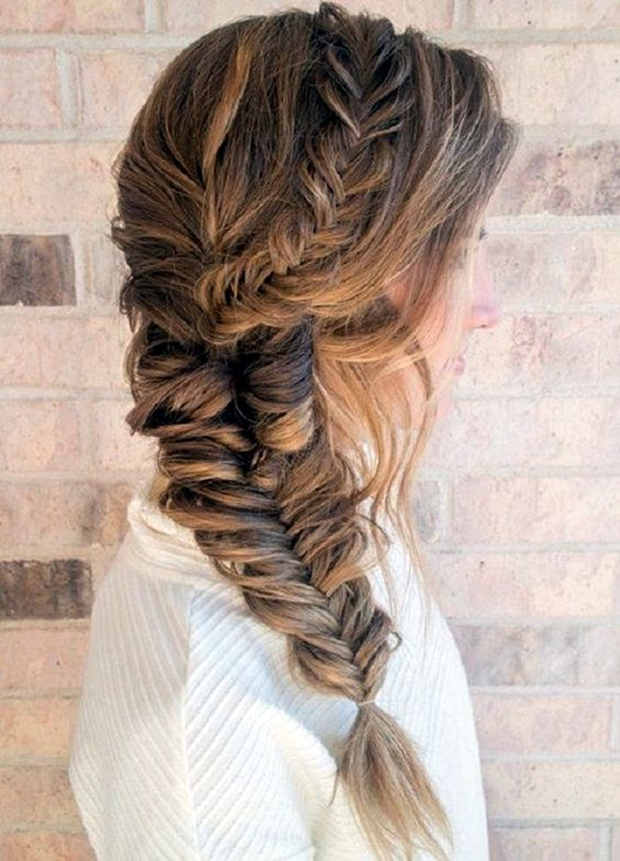 a fishtail braid of two parts and some loose hair for a casual and relaxed look