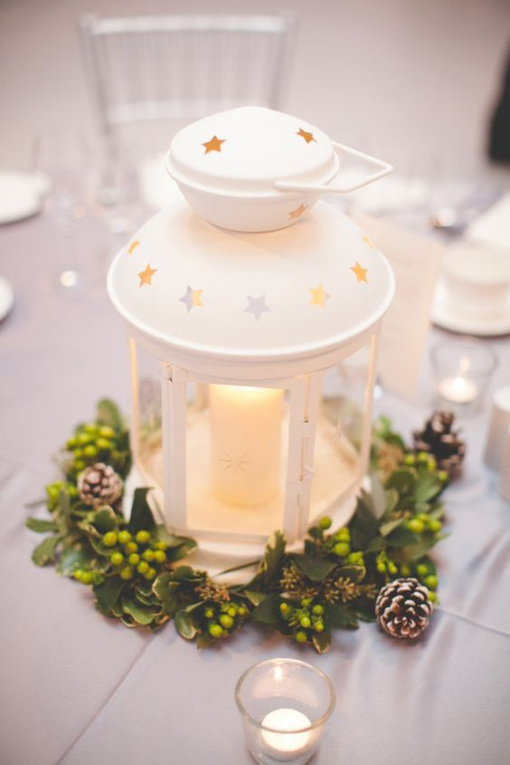 IKEA Rotera lantern is used for creating a romantic centerpiece with greenery and pinecones