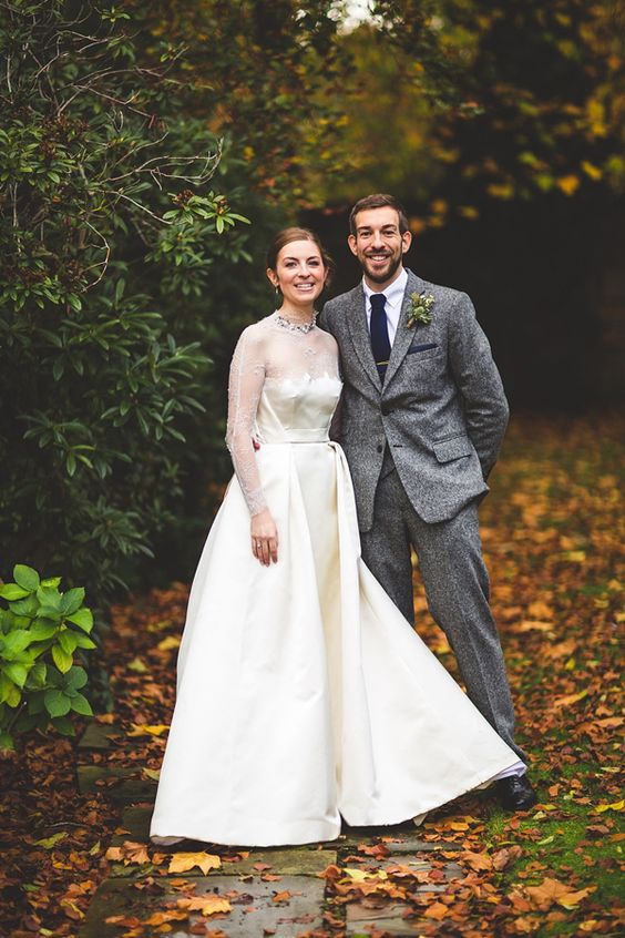 a grey two piece tweed wedding suit with a navy tie for a vintage inspired wedding
