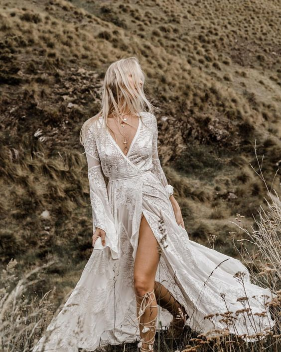 Wild Harlow wedding dress with long bell sleeves, a deep V-neckline and a thigh high slit plus lace appliques