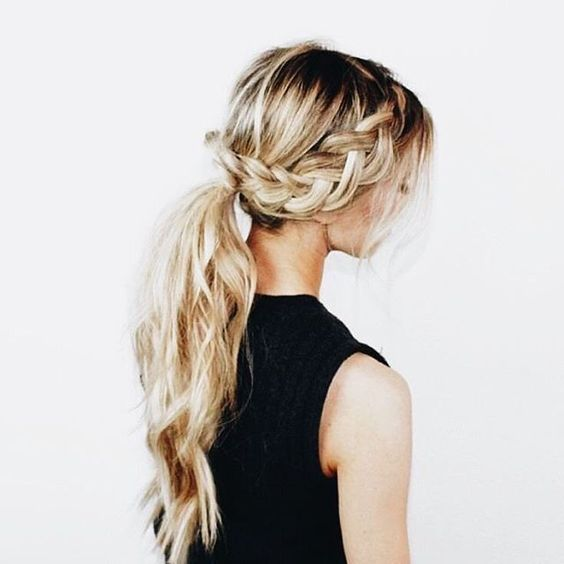 a braid going into a low ponytail with waves and locks down for a boho look