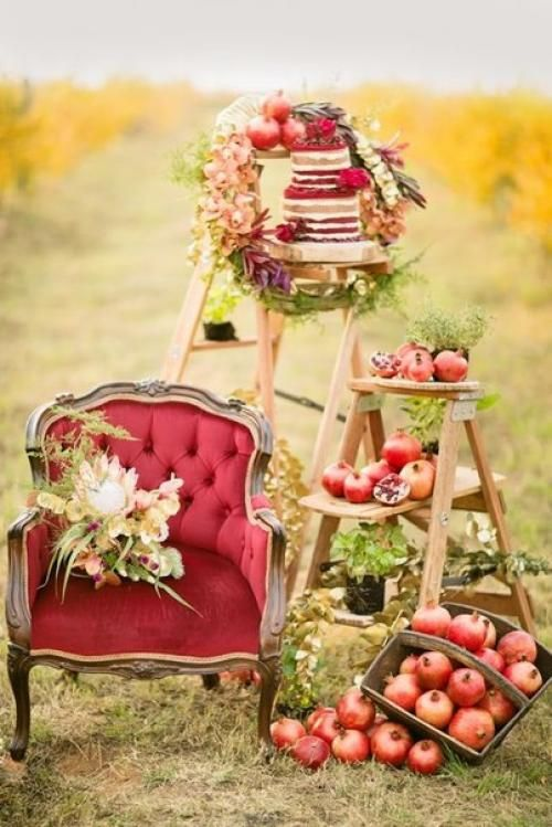 a fall pomegranate wedding with pomegranates as favors and a refined yet rustic photo booth