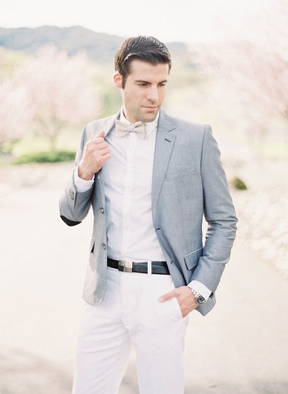 white pants and a shirt, a grey bow tie and a light grey jacket for a creative and fresh look