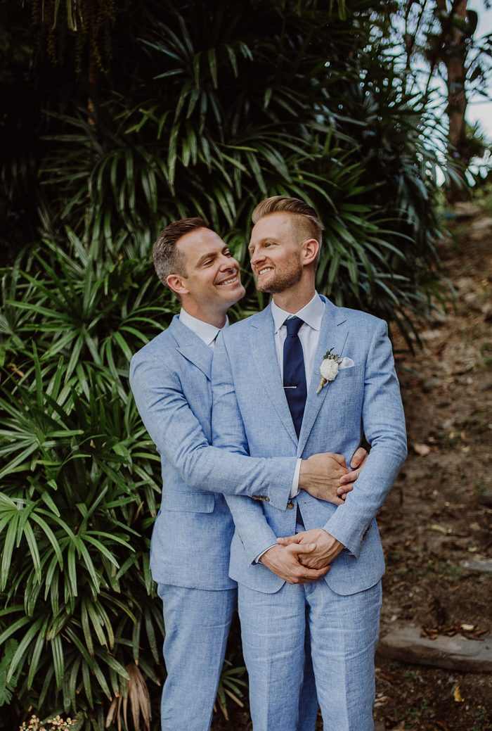 These handsome grooms were wearing light blue suits and navy ties for their oceanside garden wedding