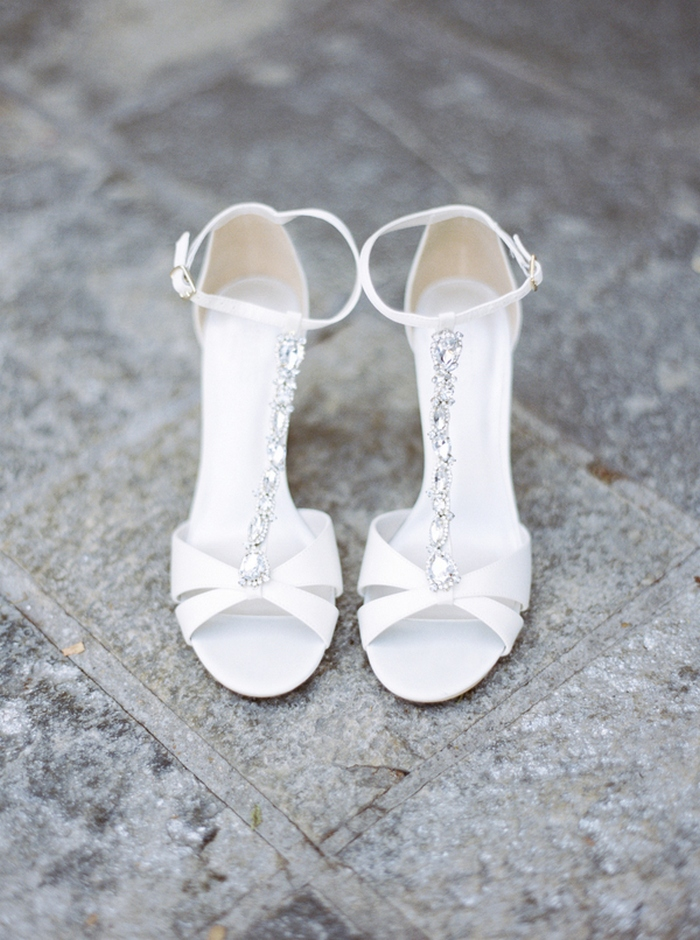 The bridal shoes were chic white embellished heels with ankle straps