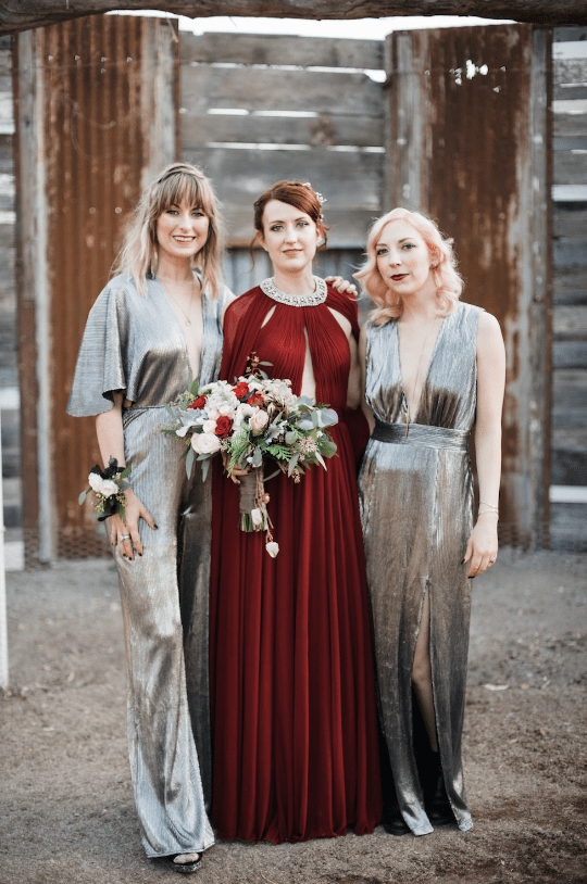 The bride was wearing a gorgeous burgundy wedding dress with an embellished neckline, and the bridesmaids were wearing silver maxi dresses with plunging necklines