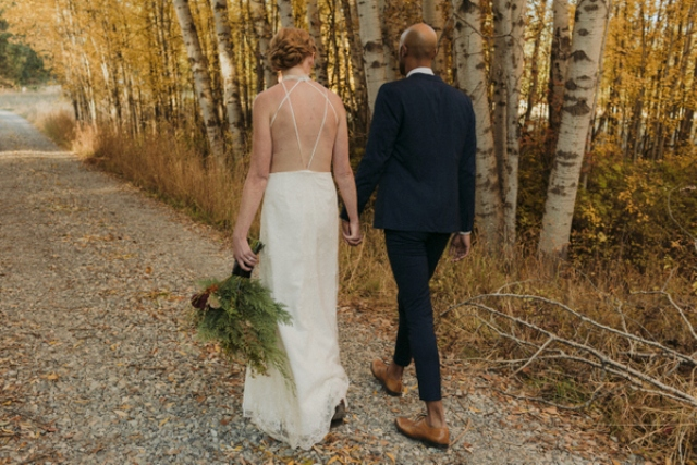 The bride was wearing a lace halter neckline wedding dress with a strappy back