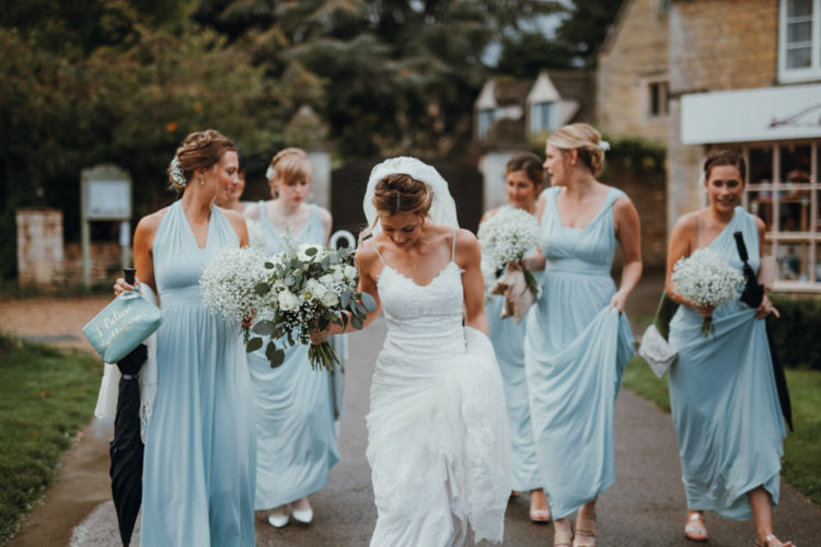 The bride was wearing a lace sheath dress with spaghetti straps, the bridesmaids were wearing light blue maxi dresses