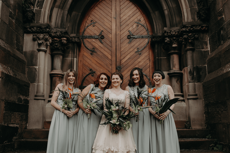 The bride was wearing a vintage-inspired midi dress with a lace bodice and the bridesmaids were rocking mint green maxi gowns