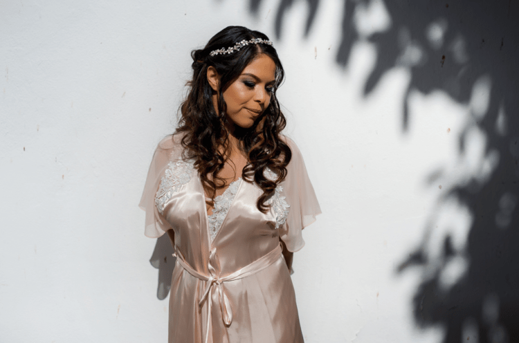 The bride was wearing waves down and an embellished hair vine