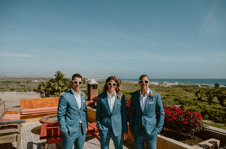 The groom and groomsmen were wearing blue suits with white shirts