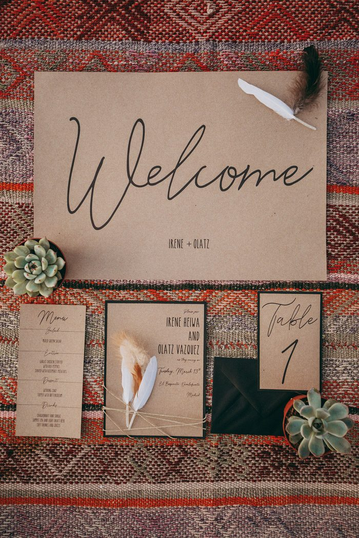 The wedding invitation suite was done with kraft paper and black calligraphy for a rustic feel