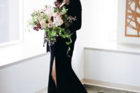 02 a black velvet long sleeve wedding dress with a V-neckline and a front slit for a wow look