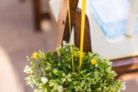 02 a cute topiary of wicker, greenery and some yellow blooms on a yellow ribbon is a creative fall idea