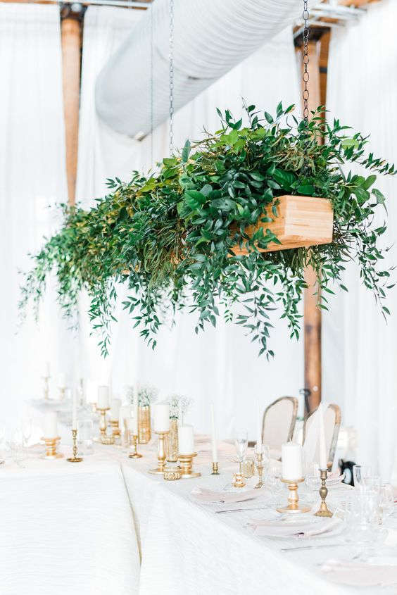 a hanging wooden box with lush greenery will instantly add freshness to the reception