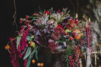 02 a luxurious wedding centerpiece with cascading blooms and foliage, colored fall leaves and berries