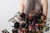 02 a moody bridal bouquet with plum, lilac, black blooms, dusty pink touches and some greenery