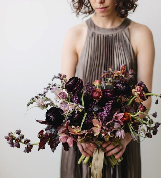 a moody bridal bouquet with plum, lilac, black blooms, dusty pink touches and some greenery