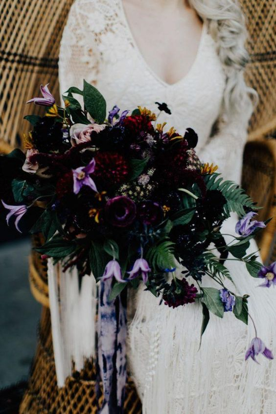 a stunning dark bouquet in black deep red and purple plus lilac shades and watercolor ribbons