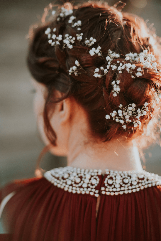 Her hair was a braided updo with baby's breath tucked in