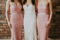 03 The bride was wearing a lace strapless sheath wedding dress, and the bridesmaids were wearing similar gowns in pink