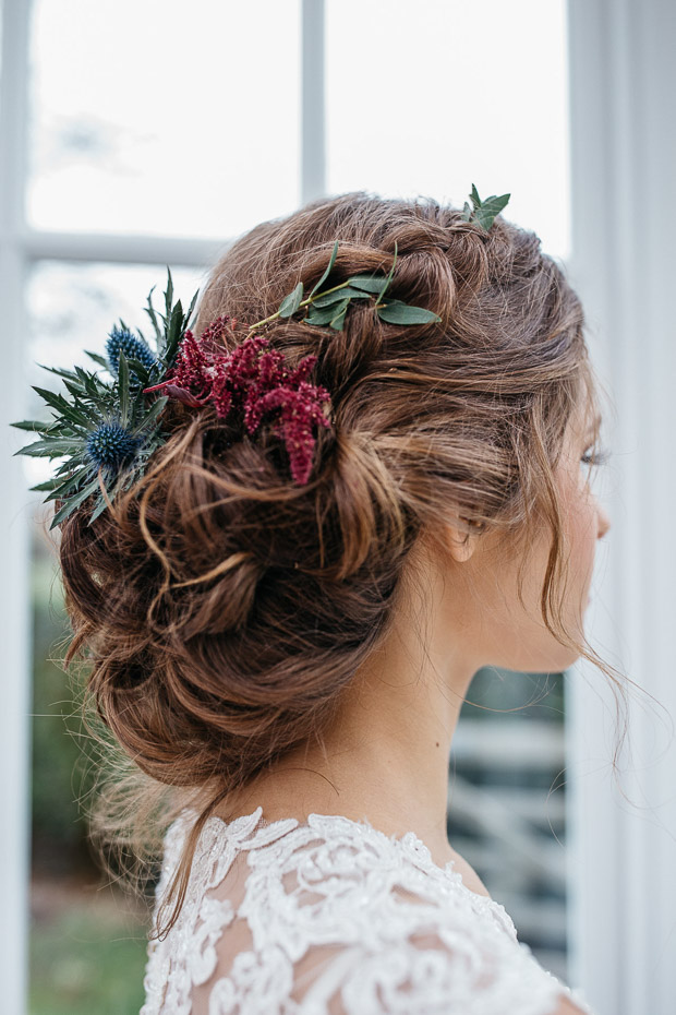 The first bridal hairstyle was done with blooms and greenery and some loose waves
