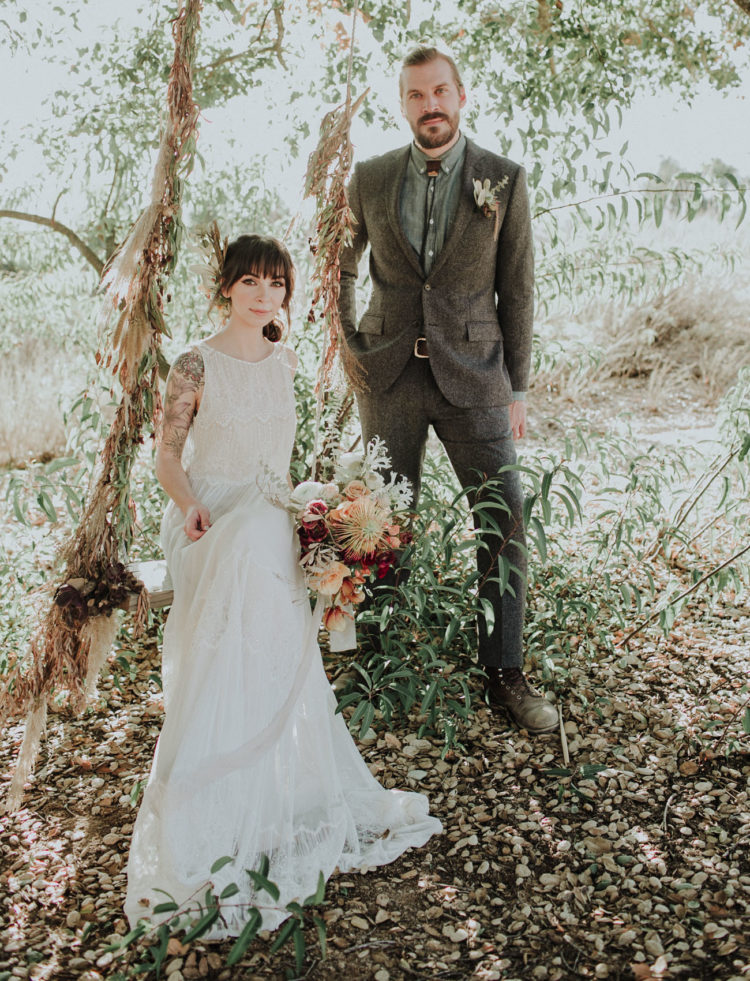 The groom was rocking a grey tweed suit, a grey shirt and a bolo tie for a vitnage boho look