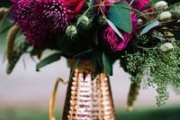 03 a chic fall wedding centerpiece of a copper pitcher, lush greenery and plum-colored blooms for a wow look
