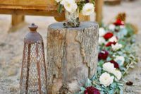 03 a gorgeous floral garland in white and burgundy and matching floral arrangements for a fall wedding