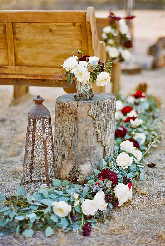 a gorgeous floral garland in white and burgundy and matching floral arrangements for a fall wedding