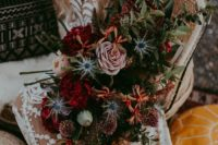 03 a lush moody bridal bouquet with burgundy, blush, rust blooms, lots of greenery andblue thistles