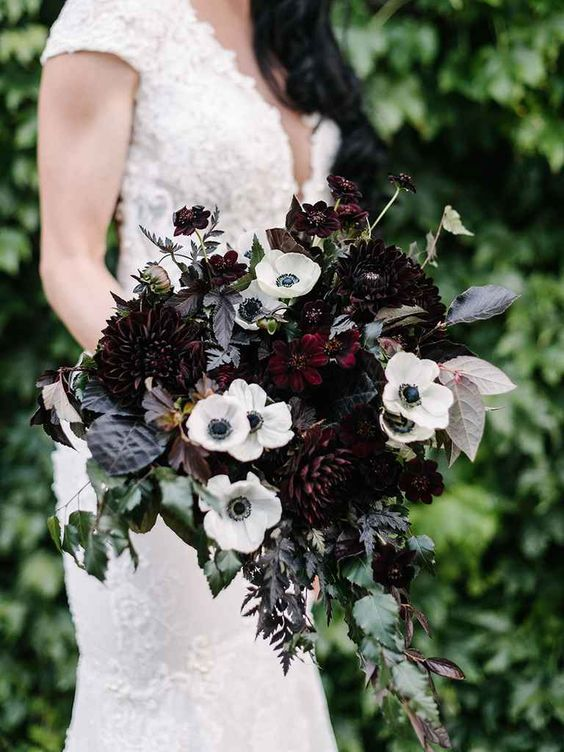 Picture Of An Elegant Wedding Bouquet With White Anemones Dark Purple Dahlias And Cascading Greenery