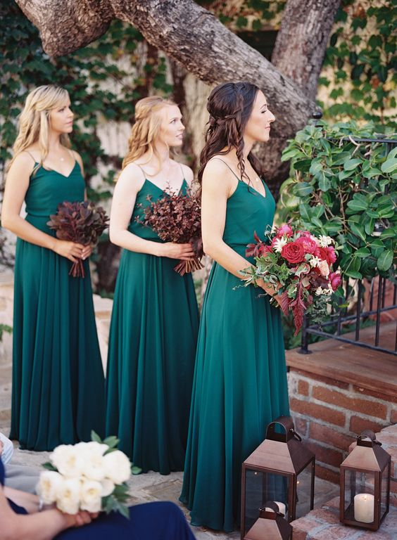 emerald spaghetti strap dresses with pleated skirts and fall-like colorful bouquets