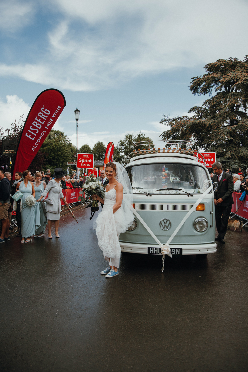 The bride in sneakers anda 60s van   what can be better for a fun wedding