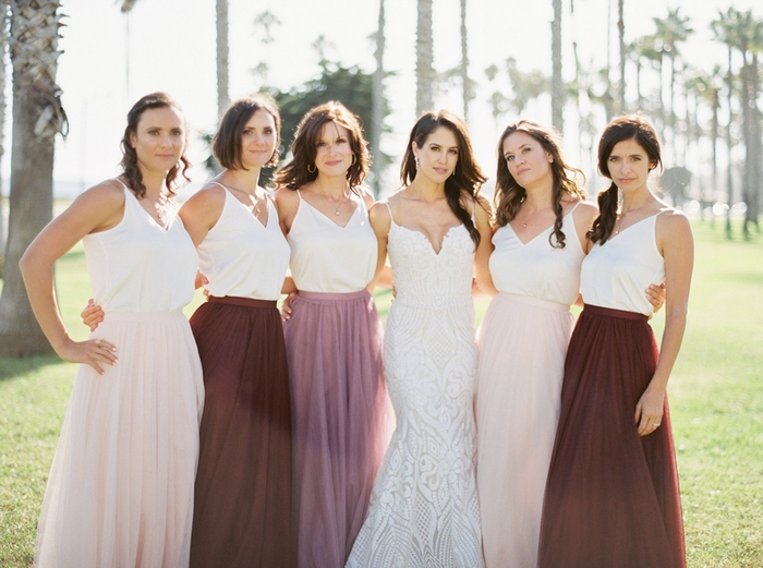 The bridesmaids were rocking separates with white spaghetti strap tops and colorful maxi skirts