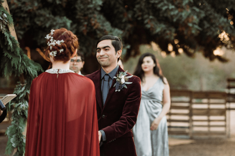 The groom was wearing a grey shirt, tie and a burgundy velvet jacket for a catchy look