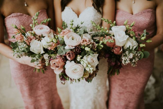 The wedding bouquets were done in white and dusty pink plus greenery