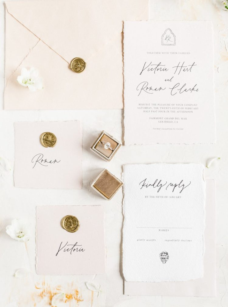 The wedding invitation suite was done in blush, with black calligraphy and gold stamps