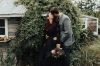 04 a beautiful black wedding dress with a lace bodice with long sleeves and a layered tulle skirt with a train