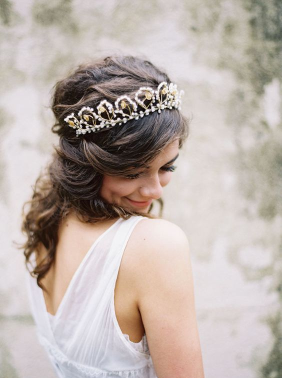 a catchy bridal tiara with pearls and rhinestones is sure to add a sophisticated feel to your look