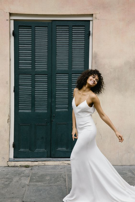a light slip wedding dress with a highlighted waistline and a train is classics for summer