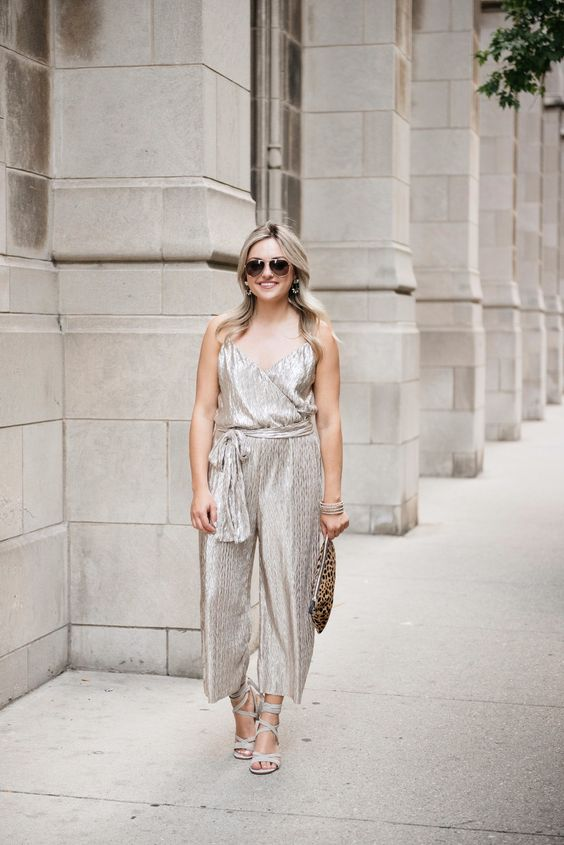 a silver jumpsuit with sashes, strappy heels and a leopard print clutch for a bold look